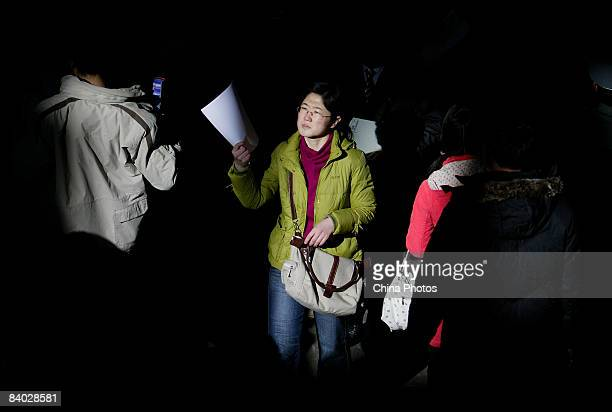A job seeker prepares to hands in her resume at a job fair for postgraduate students on December 14 2008 in Beijing China Nearly 40000 applicants...