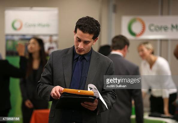 A job seeker prepares to meet with recruiters during a HireLive career fair on June 4 2015 in San Francisco California According to a report by...