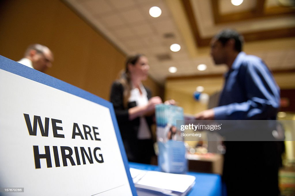 A job seeker, right, speaks with a recruiter during a HIREvent job fair in San Jose, California, U.S., on Tuesday, Dec. 4, 2012. The U.S. Labor Department is scheduled to release initial jobless claims data on Dec. 6. Photographer: David Paul Morris/Bloomberg via Getty Images