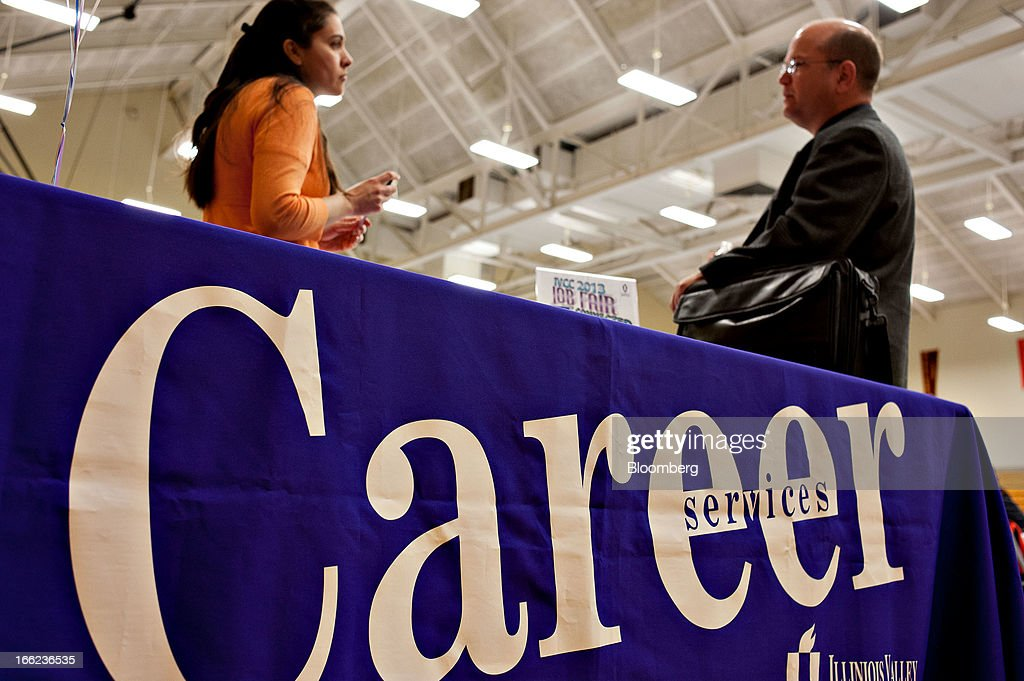 A job seeker, right, talks with an Illinois Valley Community College (IVCC) career services advisor during a job fair in Oglesby, Illinois, U.S., on Wednesday, April 10, 2013. The U.S. Department of Labor is scheduled to release jobless claims figures on April 11. Photographer: Daniel Acker/Bloomberg via Getty Images