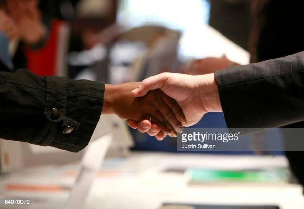 A job seeker shakes hands with a potential employer during the 'Put Your Talent to Work' job and resource expo December 17 2008 in Concord California...