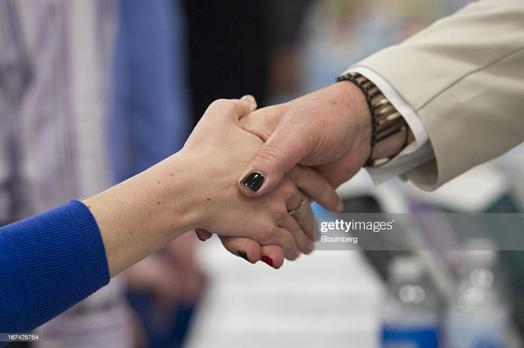 A job seeker shakes hands with a recruiter at the Spring LGBT Career Fair in San Francisco, California, U.S., on Wednesday, April 24, 2013. Fewer Americans than forecast filed first-time claims for unemployment insurance payments last week, pointing to an improving labor market. Photographer: David Paul Morris/Bloomberg via Getty Images