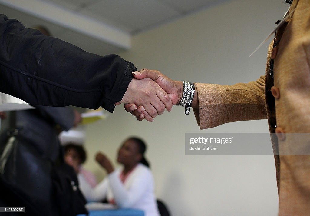 A job seeker shakes hands with a recruiter during a job fair hosted by the State of New York at the Shirley A Chisholm State Office Building on April...