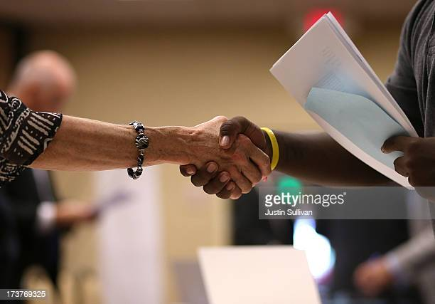 A job seeker shakes hands with a recruiter during the East Bay's HIREvent on July 17 2013 in Emeryville California Dozens of job seekers attended the...