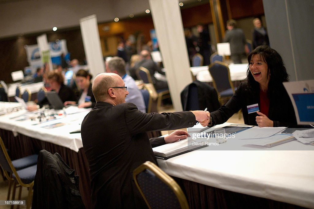 A job seeker (L) shakes hands with job recruiters during a Job fair organized by the ImmigrationOffice of Quebec in Paris and the Catalonia Employment Service (SOC) on November 29, 2012 in Barcelona, Spain. Over 40 companies from Quebec are offering more than 1000 jobs at two career fairs being held in Barcelona and Paris. Approximately 1300 job seekers attended today's fair in Barcelona after the unemployment rate in Spain increased to 25.02 percent in the third quarter of 2012, the highest in the EU.