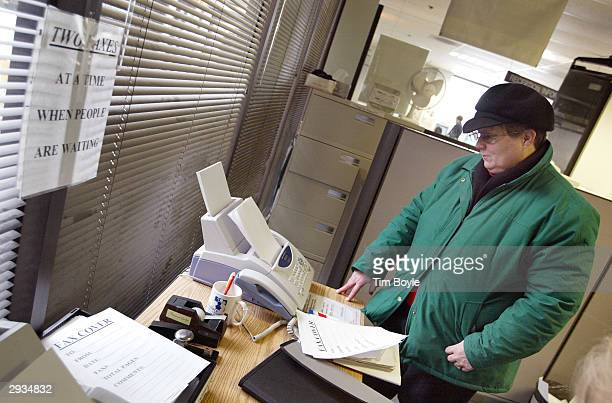 Job seeker Sonja Polony from Wheeling Illinois faxes resumes while looking for employment opportunities at an Illinois Employment and Training Center...
