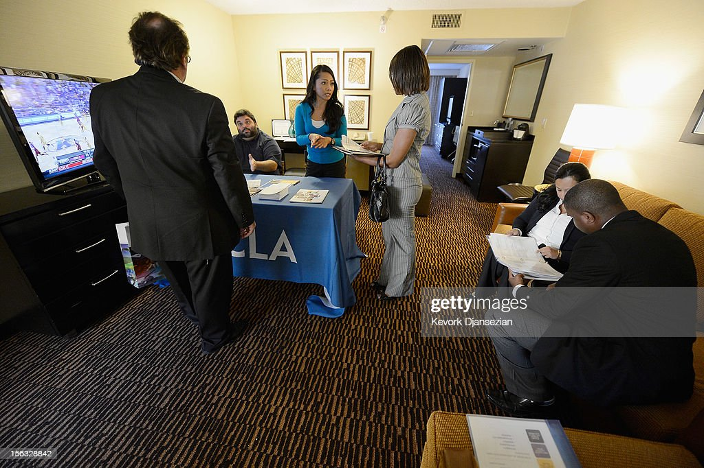 A job seeker speak with job recruiters during Professional and Executive Diversity Job Fair at a Embassy Suites hotel on November 13, 2012 in Los Angeles, California. According to reports, if Congress does not take action nearly 2 million unemployed workers are scheduled to lose their unemployment benefits at the end of 2012.