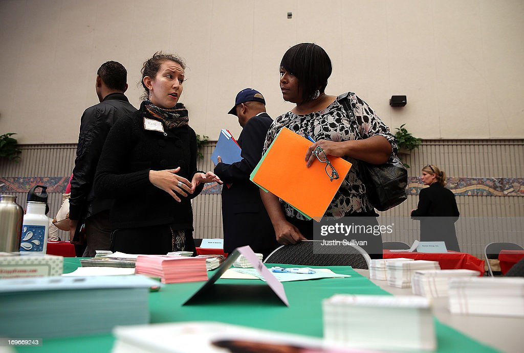 A job seeker (R) speaks with a recruiter during a job and career fair at City College of San Francisco southeast campus on May 30, 2013 in San Francisco, California. Hundreds of job seekers attended a career fair hosted by the San Francisco Southeast Community Facility Commission.