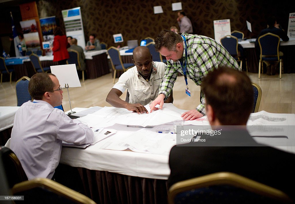 A job seeker (C) speaks with job recruiters during a job fair organized by the Immigration Office of Quebec in Paris and the Catalonia Employment Service (SOC) on November 29, 2012 in Barcelona, Spain. Over 40 companies from Quebec are offering more than 1000 jobs at two career fairs being held in Barcelona and Paris. Approximately 1300 job seekers attended today's fair in Barcelona after the unemployment rate in Spain increased to 25.02 percent in the third quarter of 2012, the highest in the EU.