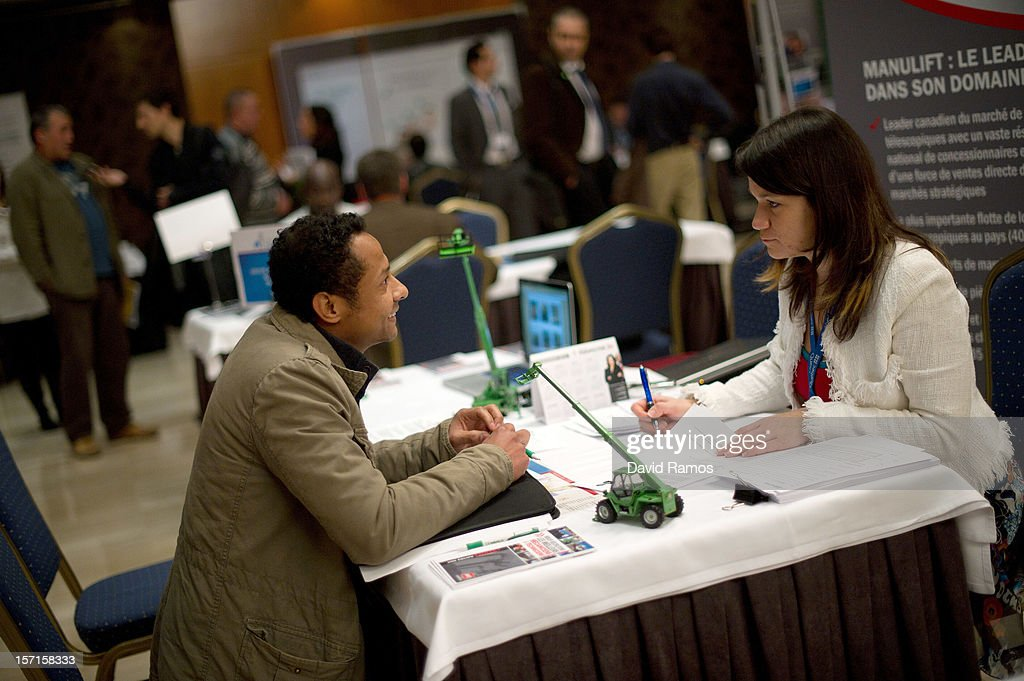 A job seeker (L) speaks with job recruiters during a job fair organized by the Immigration Office of Quebec in Paris and the Catalonia Employment Service (SOC) on November 29, 2012 in Barcelona, Spain. Over 40 companies from Quebec are offering more than 1000 jobs at two career fairs being held in Barcelona and Paris. Approximately 1300 job seekers attended today's fair in Barcelona after the unemployment rate in Spain increased to 25.02 percent in the third quarter of 2012, the highest in the EU.