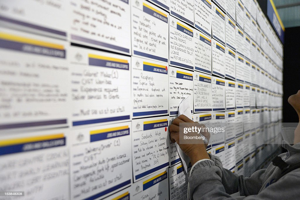 A job seeker takes notes as he browses job notices at a jobs and skills expo run by the Australian government in Melbourne, Australia, on Thursday, Oct. 4, 2012. Australia's unemployment rate probably climbed to 5.3 percent last month from 5.1 percent in August, according to the median estimate of economists surveyed by Bloomberg News. Photographer: Carla Gottgens/Bloomberg via Getty Images