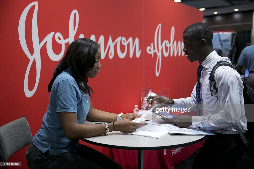 A job seeker talks to a Johnson & Johnson job recruiter at the Black Data Processing Associates (BDPA) career fair in Washington, D.C., U.S., on Friday, Aug. 16, 2013. The U.S. Department of Labor is scheduled to release initial jobless claims on Aug. 22. Photographer: Andrew Harrer/Bloomberg via Getty Images