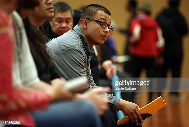 A job seeker waits to be interviewed during a job fair at California's Great America theme park on February 6 2015 in Santa Clara California Hundreds...