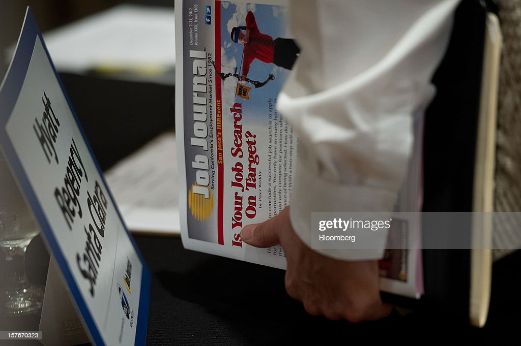 A job seeker waits to speak to a recruiter during a HIREvent job fair in San Jose, California, U.S., on Tuesday, Dec. 4, 2012. The U.S. Labor Department is scheduled to release initial jobless claims data on Dec. 6. Photographer: David Paul Morris/Bloomberg via Getty Images