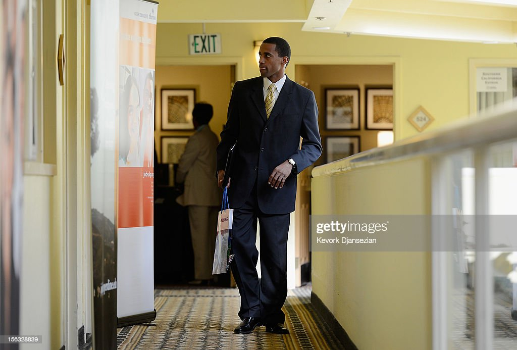 A job seekerattends the Professional and Executive Diversity Job Fair at a Embassy Suites hotel on November 13, 2012 in Los Angeles, California. According to reports if Congress does not take action nearly 2 million unemployed workers are scheduled to lose their unemployment benefits at the end of 2012.