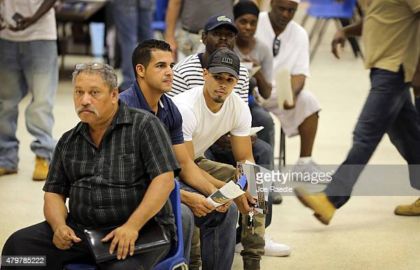 Job seekers are seated as they wait for an opportunity to apply for a job during the Miami Worldcenter construction job fair on July 7 2015 in Miami...