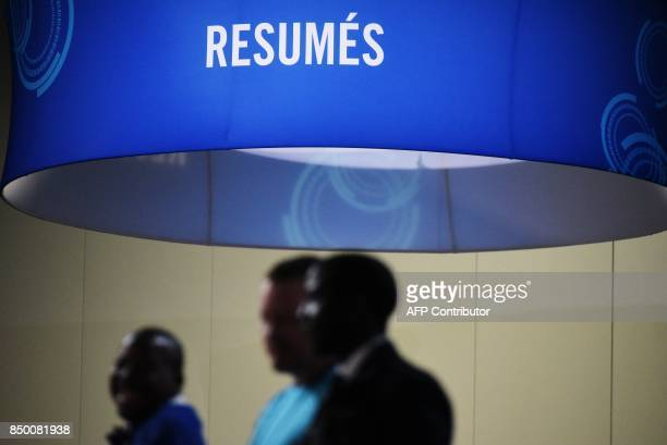 Job seekers arrive at the Walter E Washington Convention Center for The Opportunity Hiring Fair in Washington DC on September 20 2017 / AFP PHOTO /...