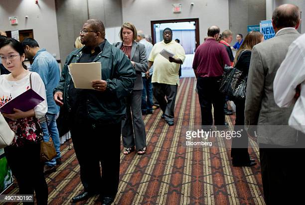 Job seekers attend a Job Fair Giant career fair in Sterling Heights Michigan US on Wednesday Sept 30 2015 The US Department of Labor is scheduled to...