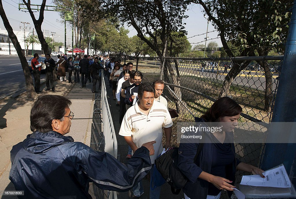 Job seekers begin to enter the XXVII job fair after waiting in line at the Palacio de los Deportes in Mexico City, Mexico, on Thursday, April 18, 2013. Mexico created 53,994 permanent and temporary urban jobs in March, according to reports from the Mexican Social Security Institute (IMSS). Photographer: Susana Gonzalez/Bloomberg via Getty Images