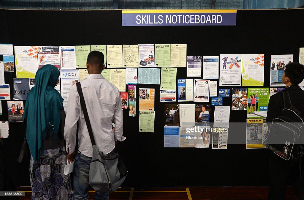 Job seekers browse a skills notice board at a jobs and skills expo run by the Australian government in Melbourne, Australia, on Thursday, Oct. 4, 2012. Australia's unemployment rate probably climbed to 5.3 percent last month from 5.1 percent in August, according to the median estimate of economists surveyed by Bloomberg News. Photographer: Carla Gottgens/Bloomberg via Getty Images