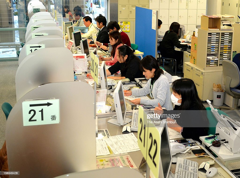 Job seekers consult the staffs of Hello Work, public employment office on December 12, 2012 in Tottori, Japan. The Japan's unemployment rate of October 2012 was 4.2 percent.