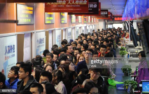 Job seekers crowd at the labour market to find jobs on February 4 2017 in Taiyuan Shanxi Province of China Every year after China's Spring Festival...