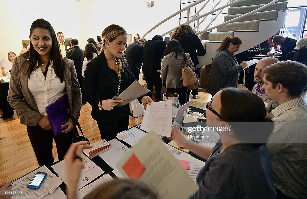 Job seekers drop off resumes during the NYC Restaurant Job Expo at the Gabarron Foundation in New York, U.S., on Tuesday, April 9, 2013. The U.S. Department of Labor is scheduled to release jobless claims figures on April 11. Photographer: Peter Foley/Bloomberg via Getty Images