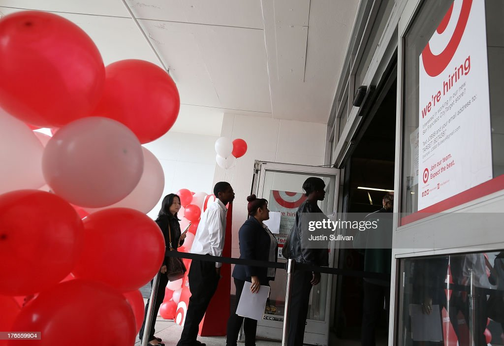 Job seekers enter a job fair at a new Target retail store on August 15, 2013 in San Francisco, California. Hundreds of job seekers applied for jobs during a job fair to staff a new Target City store. According to a report by the Labor Department, the number of people seeking first time unemployment benefits fell to the lowest level since 2007 with initial jobless claims decreasing by 15,000 to 320,000.