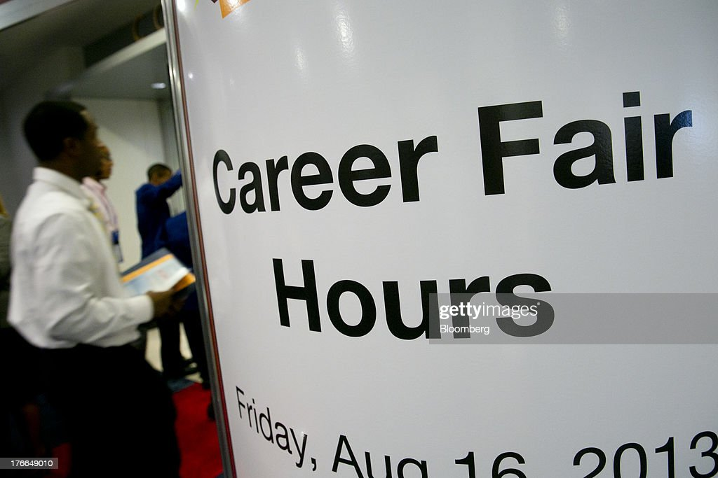 Job seekers enter the Black Data Processing Associates (BDPA) career fair in Washington, D.C., U.S., on Friday, Aug. 16, 2013. The U.S. Department of Labor is scheduled to release initial jobless claims on Aug. 22. Photographer: Andrew Harrer/Bloomberg via Getty Images