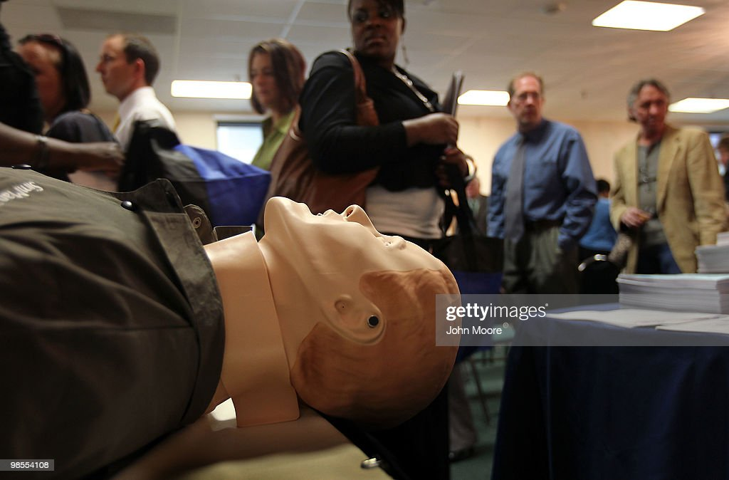 Job seekers file past a dummy at a booth for first responders courses at the 'Job Hunters Boot Camp' on April 19, 2010 in Aurora, Colorado. Hundreds of unemployed job seekers turned out for the seminar and job fair sponsored by U.S. Rep. Ed Perlmutter (D-CO). Sessions at the conference included tips to landing a federal job, improving interview skills, writing resumes and using social networking to find employment. Local colleges advertised courses for first responder training and companies took employment applications.