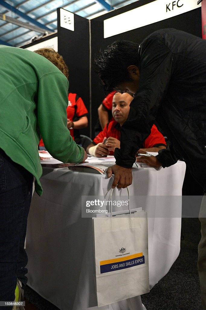 Job seekers fill out application forms at the stand for KFC, a unit of Yum! Brands Inc., at a jobs and skills expo run by the Australian government in Melbourne, Australia, on Thursday, Oct. 4, 2012. Australia's unemployment rate probably climbed to 5.3 percent last month from 5.1 percent in August, according to the median estimate of economists surveyed by Bloomberg News. Photographer: Carla Gottgens/Bloomberg via Getty Images