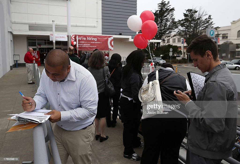 Job seekers fill out applications as they wait in line to enter a job fair at a new Target retail store on August 15, 2013 in San Francisco, California. Hundreds of job seekers applied for jobs during a job fair to staff a new Target City store. According to a report by the Labor Department, the number of people seeking first time unemployment benefits fell to the lowest level since 2007 with initial jobless claims decreasing by 15,000 to 320,000.