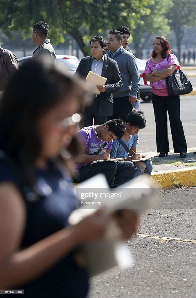 Job seekers fill out applications before entering the XXVII job fair at the Palacio de los Deportes in Mexico City, Mexico, on Thursday, April 18, 2013. Mexico created 53,994 permanent and temporary urban jobs in March, according to reports from the Mexican Social Security Institute (IMSS). Photographer: Susana Gonzalez/Bloomberg via Getty Images