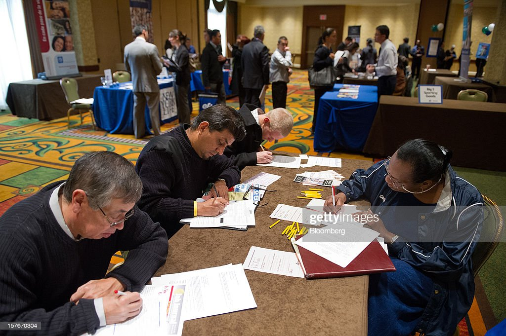 Job seekers fill out applications during a HIREvent job fair in San Jose, California, U.S., on Tuesday, Dec. 4, 2012. The U.S. Labor Department is scheduled to release initial jobless claims data on Dec. 6. Photographer: David Paul Morris/Bloomberg via Getty Images