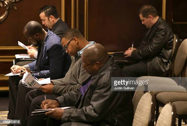 Job seekers fill out paperwork during the HireLive Career Fair on November 12 2015 in San Francisco California The national unemployment rate stands...