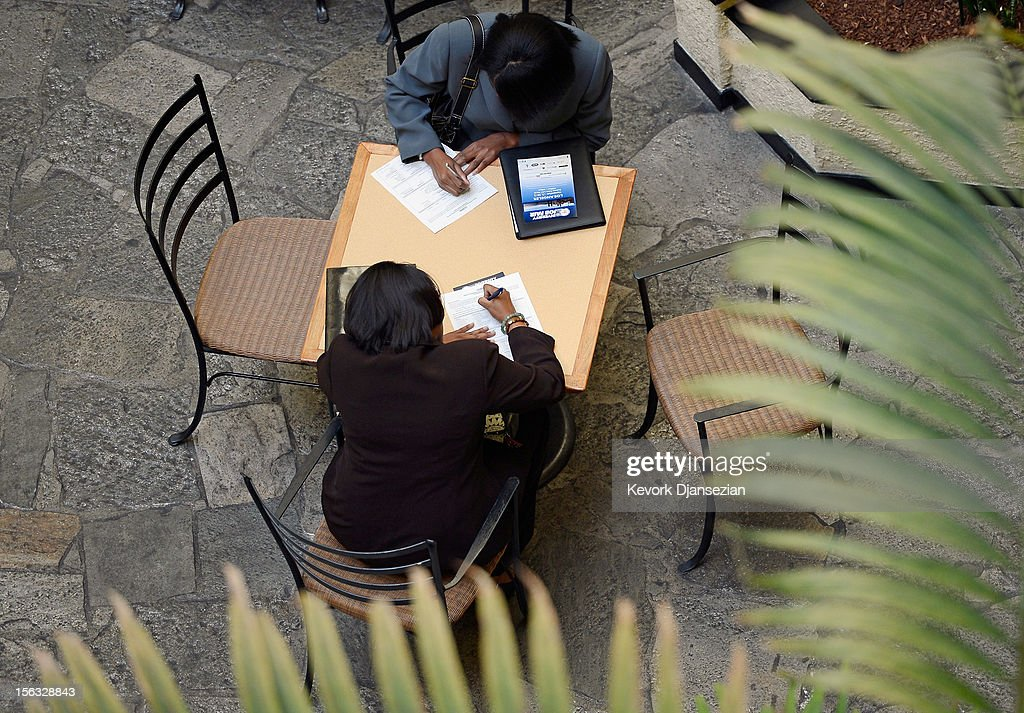 Job seekers fill up applications during the Professional and Executive Diversity Job Fair at a Embassy Suites hotel on November 13, 2012 in Los Angeles, California. According to reports if Congress does not take action nearly 2 million unemployed workers are scheduled to lose their unemployment benefits at the end of 2012.