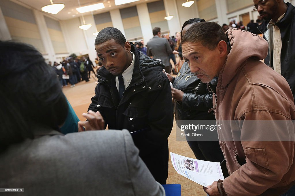 Job seekers get information about city jobs during a job fair hosted by the city of Chicago on November 9, 2012 in Chicago, Illinois. Thousands of people started to line up at 3AM for the job fair which did not begin until 9AM. When the doors opened the line was about a half-mile long.