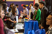 Job seekers left speak with recruiters during a career fair at San Francisco State University in San Francisco California US on Friday April 3 2015...