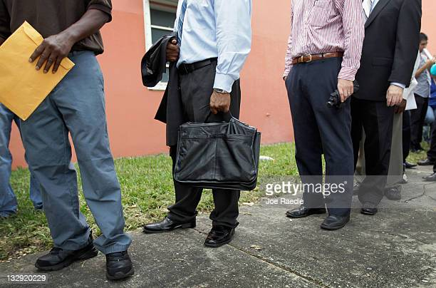 Job seekers line up to apply for an opening with Major League Baseball's Miami Marlins on November 15 2011 in Miami Florida The major league baseball...