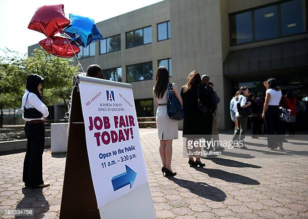 Job seekers line up to enter a job fair at the Alameda County Office of Education on April 24 2013 in Hayward California Over 100 job seekers...