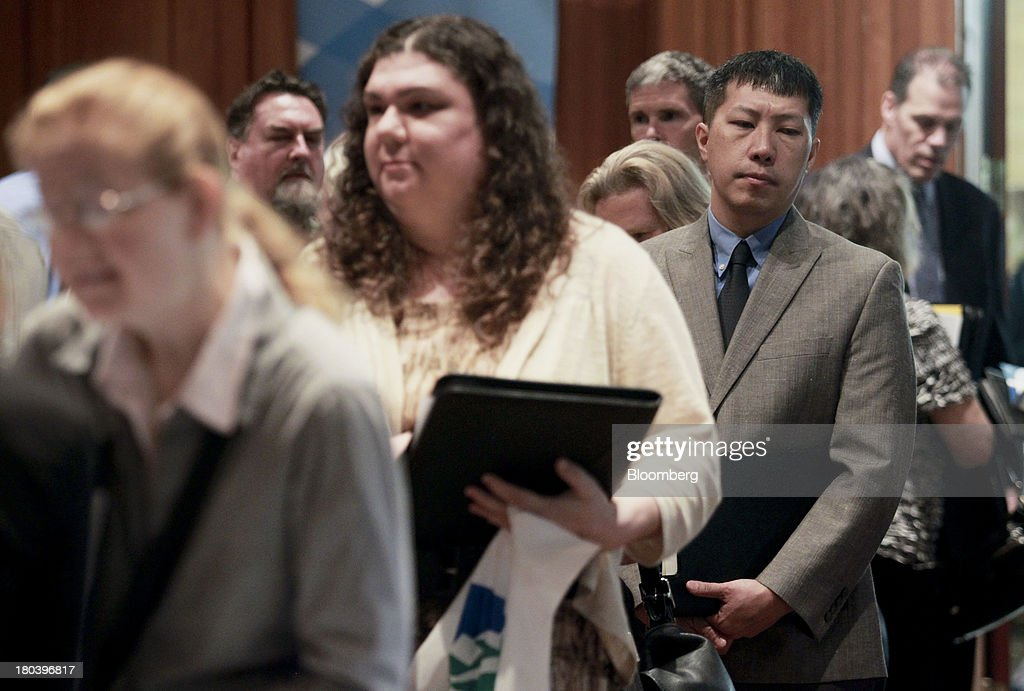 Job seekers line up to introduce themselves to potential employers at the annual Maximum Connections job fair in Portland, Oregon, U.S., on Thursday, Sept. 12, 2013. Jobless claims in the U.S. declined last week to the lowest level since April 2006 as work on computer systems in two states caused those employment agencies to report fewer applications. Photographer: Natalie Behring/Bloomberg via Getty Images