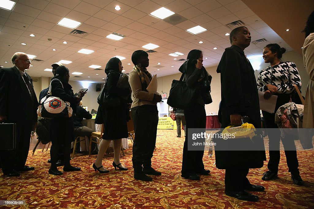Job seekers line up to meet potential employers at a career fair on April 18, 2013 at the Holiday Inn in Midtown in New York City. The event was held by National Career Fairs which expected some 700 job seekers would come to meet 20 potential employers.