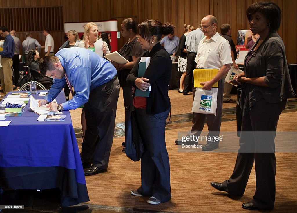 Job seekers line up to meet potential employers at the annual Maximum Connections job fair in Portland, Oregon, U.S., on Thursday, Sept. 12, 2013. Jobless claims in the U.S. declined last week to the lowest level since April 2006 as work on computer systems in two states caused those employment agencies to report fewer applications. Photographer: Natalie Behring/Bloomberg via Getty Images
