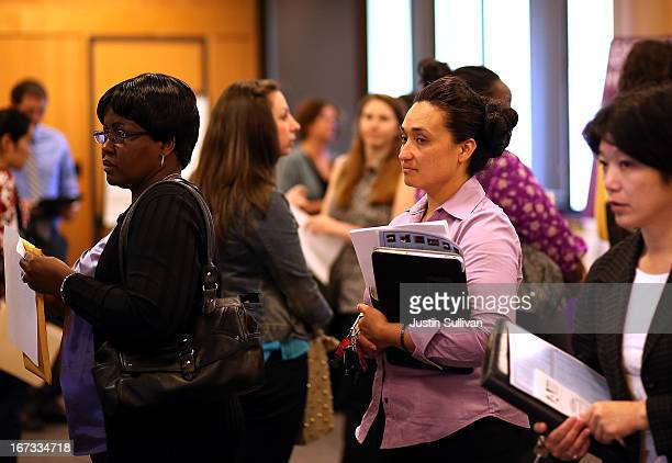 Job seekers line up to meet with a recruiter during a job fair at the Alameda County Office of Education on April 24 2013 in Hayward California Over...