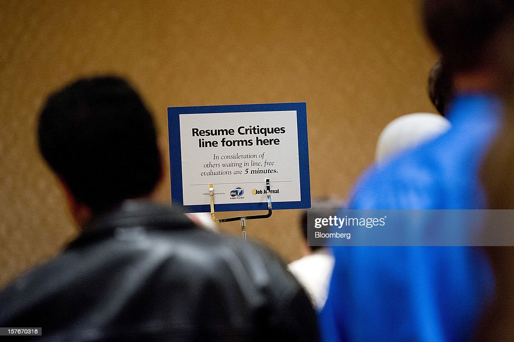 Job seekers line up to see a resume advisor during a HIREvent job fair in San Jose, California, U.S., on Tuesday, Dec. 4, 2012. The U.S. Labor Department is scheduled to release initial jobless claims data on Dec. 6. Photographer: David Paul Morris/Bloomberg via Getty Images