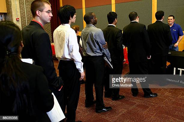 Job seekers lineup to speak to an employment representative at the New Jersey Collegiate Career Day hosted by Rutgers University on May 28 2009 in...