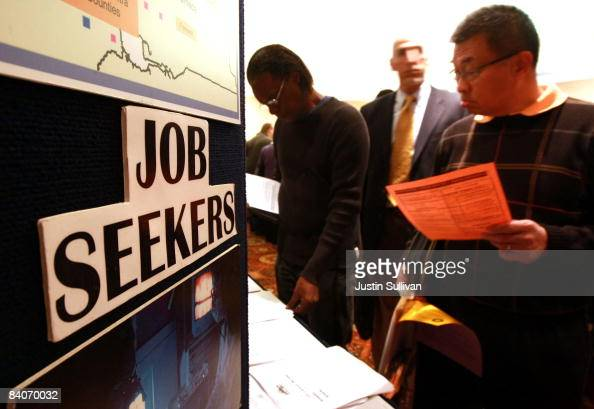 Job seekers look at job resource pamphlets during the 'Put Your Talent to Work' job and resource expo December 17 2008 in Concord California The...