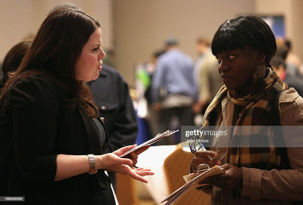 Job seekers meet meet potential employers at a career fair on April 18, 2013 at the Holiday Inn in Midtown in New York City. The event was held by National Career Fairs which expected some 700 job seekers would come to meet 20 potential employers.