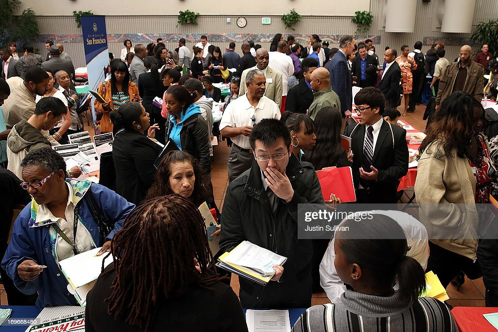 Job seekers meet with a recruiter during a job and career fair at City College of San Francisco southeast campus on May 30, 2013 in San Francisco, California. Hundreds of job seekers attended a career fair hosted by the San Francisco Southeast Community Facility Commission.