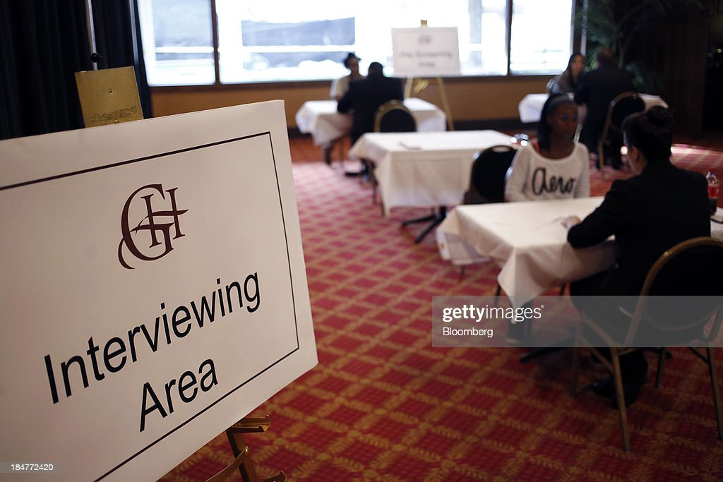 Job seekers meet with recruiters during a job fair hosted by the Galt House Hotel in Louisville, Kentucky, U.S., on Monday, Oct. 14, 2013. Improvement in the U.S. labor market may soon speed up, building on gains during the past year, Federal Reserve researchers said, citing six employment indicators. Photographer: Luke Sharrett/Bloomberg via Getty Images